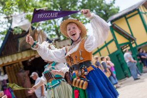Entertainment: Bristol Buskin Frolic woman with huzzah flag photo: John Karpinsky