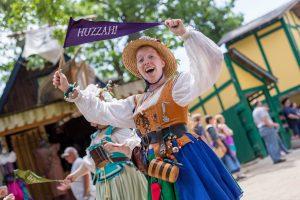 Entertainment: Bristol Buskin Frolic woman with huzzah flag photo: John Karpinsky