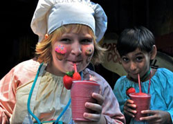 children with strawberry smoothie beverage